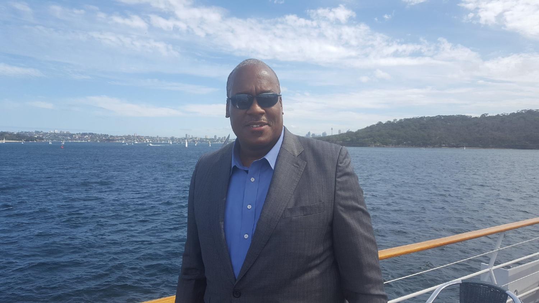 Dr. Tony Rhem on a yacht in Sydney Harbor